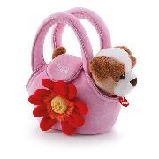 Hund in Tasche mit Blume